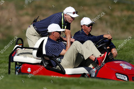US team captain Jim Furyk, center, and US team vice-captain Davis Love III, left, ride a golf cart during a practice round for the 2018 Ryder Cup at Le Golf National in Saint-Quentin-en-Yvelines, outside Paris, France, . The 42nd Ryder Cup will be held in France from Sept. 28-30, 2018, at the Albatros Course of Le Golf National
