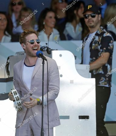 Ricky Wilson, the lead singer of the band the Kaiser Chiefs, performs during the opening ceremony of the Ryder Cup at Le Golf National in Saint-Quentin-en-Yvelines, outside Paris, France, . The 42nd Ryder Cup will be held in France from Sept. 28-30, 2018 at Le Golf National