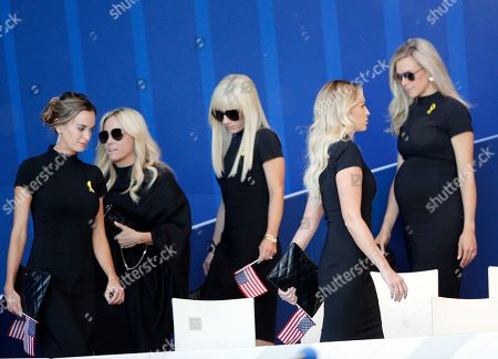 US team's wives and partners arrive to attend the opening ceremony of the Ryder Cup at Le Golf National in Saint-Quentin-en-Yvelines, outside Paris, France, . Jena Sims, left, Amy Mickelson, 2nd left, and Paulina Gretzky, 2nd right, The 42nd Ryder Cup will be held in France from Sept. 28-30, 2018 at Le Golf National