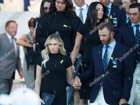 Dustin Johnson of the US and his partner Paulina Gretzky leave at the the end of the opening ceremony of the Ryder Cup at Le Golf National in Saint-Quentin-en-Yvelines, outside Paris, France, . The 42nd Ryder Cup will be held in France from Sept. 28-30, 2018 at Le Golf National