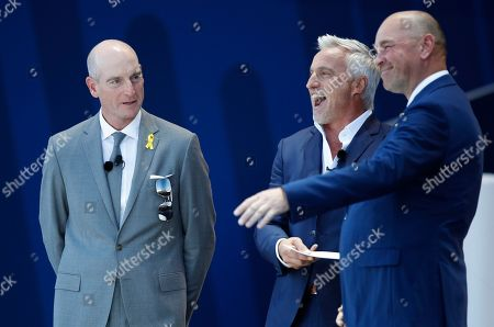 Presenter David Ginola introduces US team captain Jim Furyk, left, and Europe team captain Thomas Bjorn, right, during the opening ceremony of the Ryder Cup at Le Golf National in Saint-Quentin-en-Yvelines, outside Paris, France, . Jena Sims, left, Amy Mickelson, 2nd left, and Paulina Gretzky, 2nd right, The 42nd Ryder Cup will be held in France from Sept. 28-30, 2018 at Le Golf National