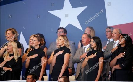 US team's wives and partners sing the national anthem during the opening ceremony of the Ryder Cup at Le Golf National in Saint-Quentin-en-Yvelines, outside Paris, France, . Jena Sims, left, Amy Mickelson, 2nd left, and Paulina Gretzky, 2nd right, The 42nd Ryder Cup will be held in France from Sept. 28-30, 2018 at Le Golf National
