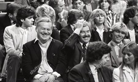 Reginald Bosanquet, Dickie Davies with other audience members watching Dudley Moore performance.