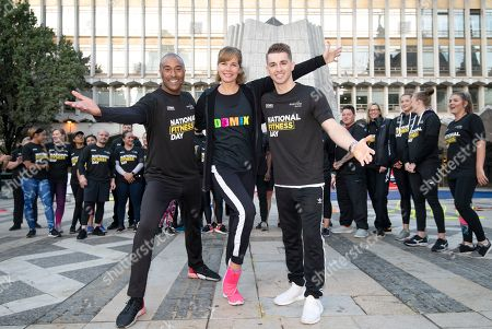Dame Darcey Bussell, Colin Jackson and Max Whitlock leading a mass workout for National Fitness Day in the courtyard of the Guildhall in the city of London.