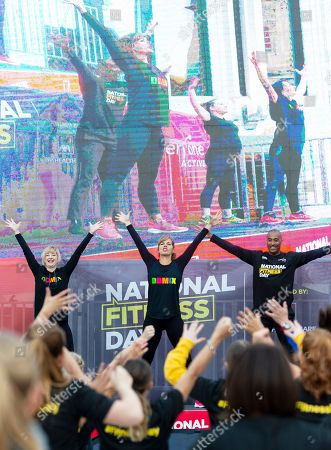 Dame Darcey Bussell and Colin Jackson leading a mass workout for National Fitness Day in the courtyard of the Guildhall in the city of London.