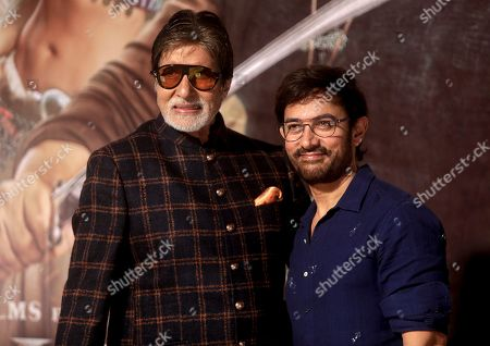 """Amitabh Bachchan, Aamir Khan. Bollywood actors Amitabh Bachchan and Aamir Khan pose for media during the trailer launch of upcoming movie """"Thugs of Hindostan"""" in Mumbai, India"""