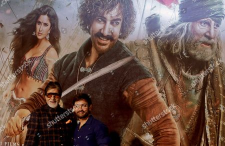 """Aamir Khan, Amitabh Bachchan. Bollywood actors Amitabh Bachchan, left, and Aamir Khan pose for media during the trailer launch of upcoming movie """"Thugs of Hindostan"""" in Mumbai, India"""