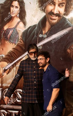 """Amitabh Bachchan, Aamir Khan. Bollywood actors Amitabh Bachchan, left and Aamir Khan pose for media during the trailer launch of upcoming movie """"Thugs of Hindostan"""" in Mumbai, India"""