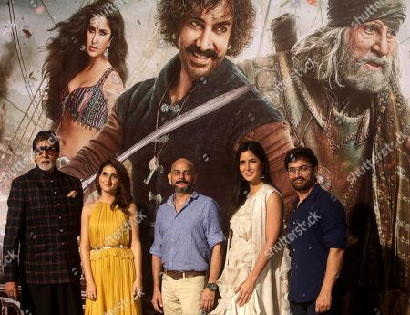 "Director Vijay Krishna Acharya, center, poses with Bollywood actors from left, Amitabh Bachchan, Fatima Sana Shaikh, Katrina Kaif and Aamir Khan,during the trailer launch of upcoming movie ""Thugs of Hindostan"" in Mumbai, India"