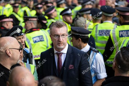 Kevin Carroll. Supporters of former EDL leader Tommy Robinson (real name Stephen Yaxley-Lennon ) outside the Old Bailey, as Robinson faces a retrial for Contempt of Court following his actions outside Leeds Crown Court in May 2018. Robinson was already serving a suspended sentence for the same offence when convicted in May and served time in jail as a consequence, but the newer conviction was quashed by the Court of Appeal and a retrial ordered