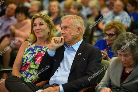 Michael Putney and wife Marta Putney (L)