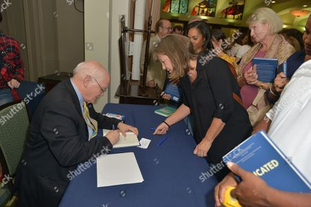 Author David Lawrence Jr. signing his book 'A Dedicated Life'
