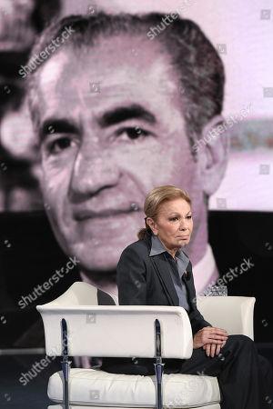 Empress Farah Pahlavi born Farah Diba widow of Mohammad Reza Pahlavi Shah of Iran in a picture on background