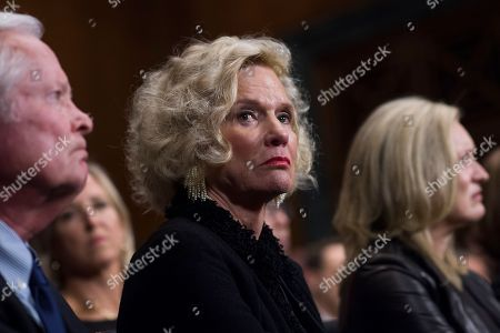 Martha and Edward Kavanaugh listen to their son, Supreme Court nominee Judge Brett Kavanaugh, during the Senate Judiciary Committee hearing, in Washington, with Laura Cox Kaplan, right