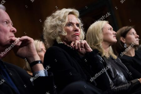 Martha and Edward Kavanaugh listen to their son, Supreme Court nominee Judge Brett Kavanaugh, during the Senate Judiciary Committee hearing, in Washington, with Laura Cox Kaplan and his wife, Ashley Estes Kavanaugh, right