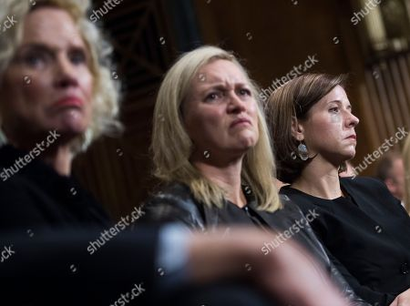Martha Kavanaugh listens to her son, Supreme Court nominee Judge Brett Kavanaugh, during the Senate Judiciary Committee hearing, in Washington, with Laura Cox Kaplan and his wife, Ashley Estes Kavanaugh, right