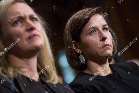 Ashley Estes Kavanaugh, right, listens to her husband, Judge Brett Kavanaugh, during the Senate Judiciary Committee hearing on his nomination with Laura Cox Kaplan