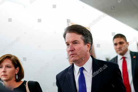 Supreme Court nominee Judge Brett Kavanaugh, center, with his wife Ashley Estes Kavanaugh, left, arrive to enter the hearing room ahead of a Senate Judiciary Committee hearing, on Capitol Hill in Washington