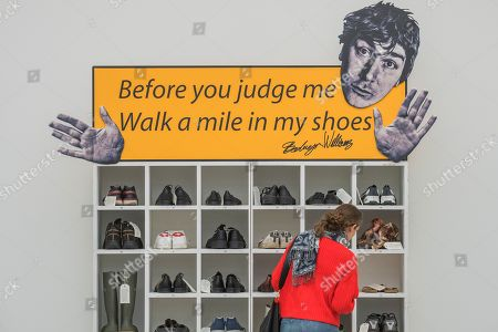 Bedwyr Williams' Walk A Mile In My Shoes, a display case with 45 pairs of his own size 13 shoes. He invites the audience to share in his own 'problems of ' by trying them on