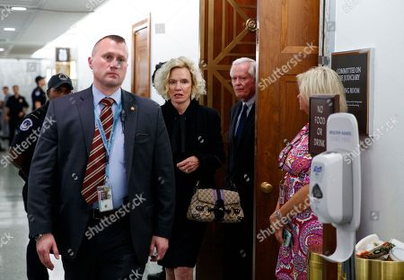 Judge Brett Kavanaugh's parents, Edward Kavanaugh and Martha Kavanaugh, walk from the hearing room during a break in a Senate Judiciary Committee hearing on Capitol Hill in Washington