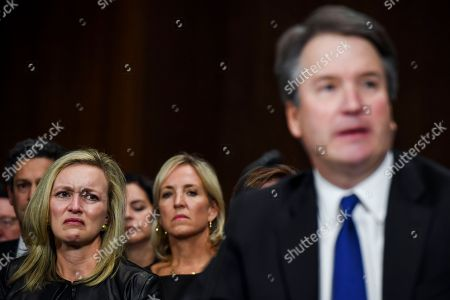 Laura Cox Kaplan (L) tears up while seated behind Supreme Court nominee Judge Brett Kavanaugh during the Senate Judiciary Committee hearing on the nomination of Brett Kavanaugh to be an associate justice of the Supreme Court of the United States, on Capitol Hill in Washington, DC, USA, 27 September 2018. US President Donald J. Trump's nominee to be a US Supreme Court associate justice Brett Kavanaugh is in a tumultuous confirmation process as multiple women have accused Kavanaugh of sexual misconduct.