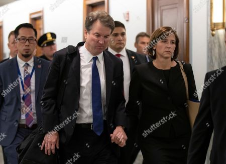 Brett Kavanaugh, Ashley Estes Kavanaugh. Supreme Court nominee Brett Kavanaugh and his wife Ashley Estes Kavanaugh depart after testifying before the Senate Judiciary Committee on Capitol Hill in Washington