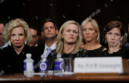 Family members of of U.S. Supreme Court nominee Brett Kavanaugh, including his wife Ashley (R) and mother Martha (L), listen to him testify before a Senate Judiciary Committee confirmation hearing on Capitol Hill in Washington, U.S., September 27, 2018.