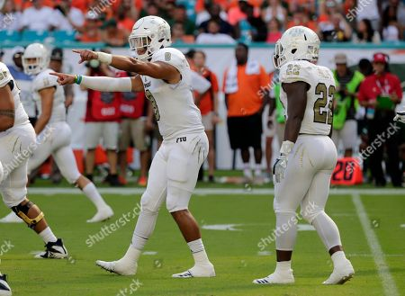 Stock Image of FIU quarterback Christian Alexander (8) calls a play during the first half of an NCAA college football game against Miami, in Miami Gardens, Fla