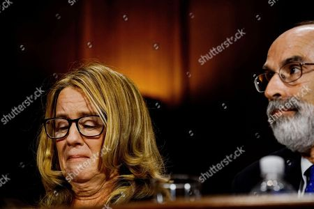 Christine Blasey Ford, left, next to one of her lawyers Michael R. Bromwich, tears up at a Senate Judiciary Committee hearing