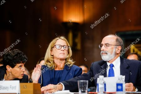 Christine Blasey Ford, with lawyers Debra Katz, left, and Michael R. Bromwich, answers questions at a Senate Judiciary Committee hearing