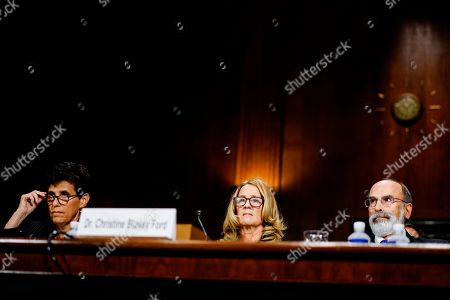 Christine Blasey Ford, center, with her lawyers Debra Katz, left, and Michael R. Bromwich