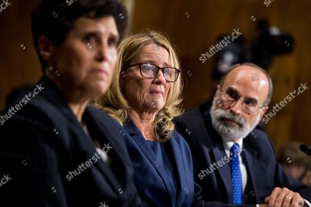 Christine Blasey Ford, center, flanked by attorneys Debra Katz (L) and Michael Bromwich, testifies during the Senate Judiciary Committee hearing on the nomination of Kavanaugh to be an associate justice of the Supreme Court of the United States, focusing on allegations of sexual assault by Kavanaugh against Christine Blasey Ford in the early 1980s.