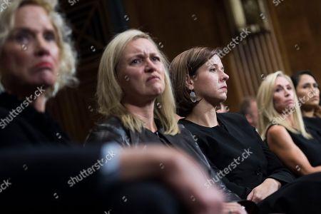 Ashley Kavanaugh listens to her husband, Judge Brett Kavanaugh, during the Senate Judiciary Committee hearing on his nomination be an associate justice of the Supreme Court of the United States, focusing on allegations of sexual assault by Kavanaugh against Christine Blasey Ford in the early 1980s. Laura Cox Kaplan appears at left.