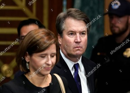 Judge Brett Kavanaugh arrives to testify with his wife Ashley Estes Kavanaugh before the Senate Judiciary Committee on Capitol Hill in Washington