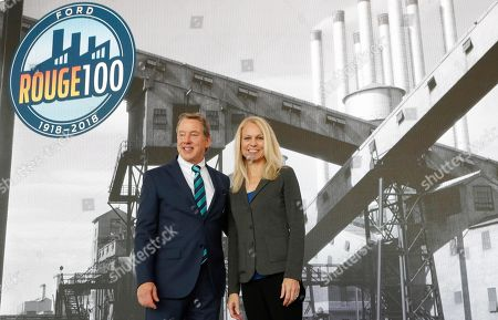 Ford Motor Co., Executive Chairman Bill Ford stands with Debbie Manzano, Ford Rouge plant manager, in Dearborn, Mich. Ford is celebrating a century of production at its storied Rouge factory in Dearborn, and made an announcement about the plant's future at a ceremony Thursday. Ford says the 600-acre factory complex is the longest continuously operating auto plant in the nation. It was designed to take in raw materials and convert them into fully assembled vehicles