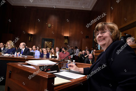 Rachel Mitchell (R), a prosecutor from Arizona, asks questions to Christine Blasey Ford (L)