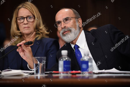 Christine Blasey Ford (L), the woman accusing Supreme Court nominee Kavanaugh of sexually assaulting her at a party 36 years ago, listens to her attorney Michael R Bromwich (R) as she testifies before the US Senate Judiciary Committee on Capitol Hill in Washington, DC