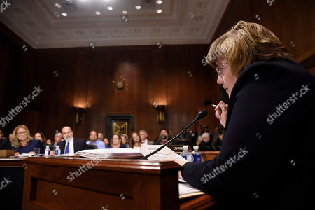 Christine Blasey Ford (L), the woman accusing Supreme Court nominee Brett Kavanaugh of sexually assaulting her at a party 36 years ago, answers questions by Rachel Mitchell (R), a prosecutor from Arizona, as she testifies before the US Senate Judiciary Committee on Capitol Hill
