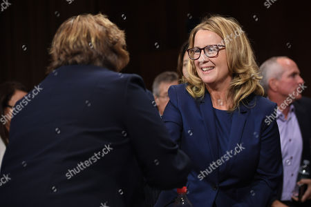 Christine Blasey Ford (R), the woman accusing Supreme Court nominee Kavanaugh of sexually assaulting her at a party 36 years ago, shakes hands with Rachel Mitchell, a prosecutor from Arizona, after she interrogated her before the US Senate Judiciary Committee on Capitol Hill.