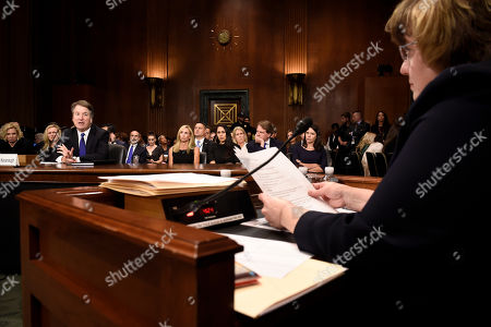 Rachel Mitchell (R), a prosecutor from Arizona, asks questions to Supreme Court nominee Judge Kavanaugh (L) as he testifies before the US Senate Judiciary Committee on Capitol Hill