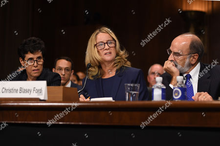 Christine Blasey Ford with her Counsels Debra S Katz (L) and Michael R Bromwich (R)