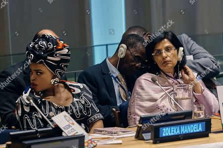 Nelson Mandela's granddaughter, Zoleka Mandela and Pakistani cardiologist, Dr. Sania Nishtar listen to the speakers during a High Level Meeting on Non-communicable Diseases at U.N. headquarters