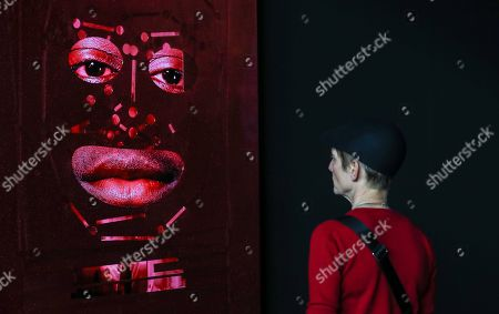 Stock Photo of A visitor looks at the artwork 'h*Z' by artist Tony Oursler, on display as part of 'Art Berlin', a fair for modern and contemporary art, in Berlin, Germany, 27 September 2018. The second edition of the event runs from 27 to 30 September 2018, with around 120 galleries from 21 countries participating. The fair takes place in two hangars of the historical Tempelhof Airport.
