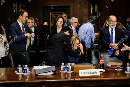 Christine Blasey Ford is hugged by her lawyer Debra S. Katz after the hearing