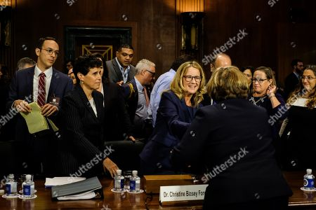 Christine Blasey Ford shook hands with Rachel Mitchell after the hearing
