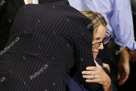 Dr. Christine Blasey Ford gets a hug from attorney Debra Katz after the Senate Judiciary Committee hearing on the nomination of Brett Kavanaugh to be an associate justice of the Supreme Court of the United States.