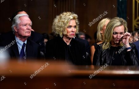 Everett Edward Kavanaugh, Jr. and Martha Kavanaugh and Laura Cox Kaplan, right, listen as Supreme Court nominee Kavanaugh testifies before the Senate Judiciary Committee on Capitol Hill