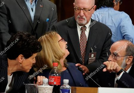 Christine Blasey Ford greets a friend, center as she listens to attorney's Debra Katz and Michael Bromwich as she testifies before the Senate Judiciary Committee on Capitol Hill
