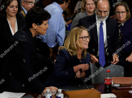 Christine Blasey Ford is hugged by her attorney Debra Katz, left, after she finished testifying before the Senate Judiciary Committee on Capitol Hill