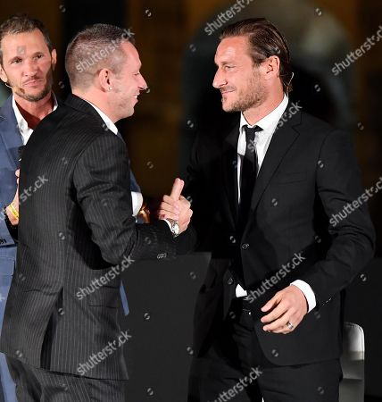 Former AS Roma's player and current manager, Francesco Totti (R) and former Italian international soccer player Antonio Cassano, attend the presentation of Totti's biography 'Un Capitano' (A Captain) at the Colosseum in Rome, Italy, 27 September 2018.